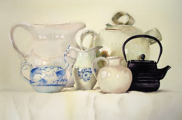 white ceramics with black teapot